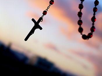 A rosary crucifix.