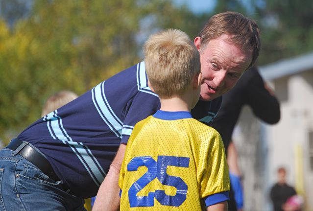 Coach encourages young athlete